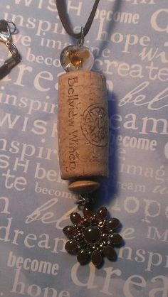 All my wine lovers...handmade cork pendant on leather cord...