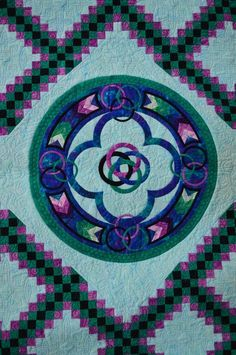 Celtic Rose,  2014 raffle quilt, Northwest Quilters' Guild raffle quilt (Portland, OR). Triple Irish Chain with Celtic medallion. Designed by Nancy Tubbs of Blue Heron Quilts, quilted by Pat Roche.  Closeup photo by Janet Eastman, Oregon Live. http://www.northwestquilters.org