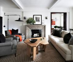 Carpet. Coffee table. Lamp. Painted deep door frames painted black.  Midtown Apartment via @MyDomaine