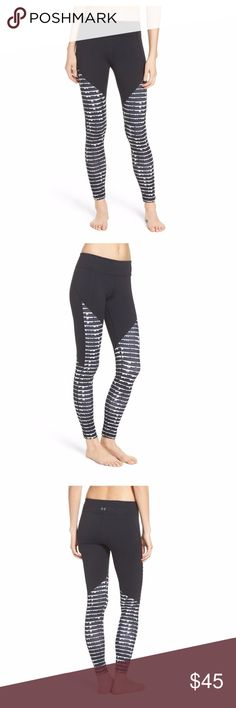 NWT Under Armour Black Mirror Workout Legging Workout in style in these great Under Armour black and white mirror legging, size XL. Figure-flattering performance fabric knit with antimicrobial technology keeps your gear fresher, longer. Antimicrobial fabric inhibits the growth of odor-causing germs. Signature Moisture Transport System dries quickly to keep you cool and comfortable. Brand NEW with tags, the perfect gift for your or a loved one!  - Size: XL - Material: 86% polyester, 14%…