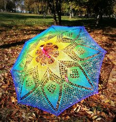 "Rainbow Mandala Parasol by Babukatorium -- ""Made of sewing thread this SUNbrella is pretty lace weight. This time I chose a Christmas star shaped doily to modify and created as blended as possible for showing better the gorgeous motif of this vintage pattern."""
