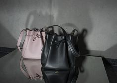 • POWDER ROSE / BLACK BUCKET BAG • Timeless bucket bags made out of Italien calf leather. Comes with an extra leather lining pouch to keep your valuables safe. #bucketbag #leather #calf #accessories #bag #handbag #timeless #rose #black #mirror #timeless #minimal #reduced #modern #contemporary #fashion #signature #trendy #raellezurich www.raellezurich.com Bag Making, Making Out, Black Bucket, Bucket Bags, Black Mirror, Contemporary Fashion, Calf Leather, Calves, Powder