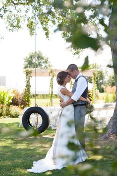 Married by the tire swing at Heritage Prairie Farm in Elburn, Illinois.  Photography by Elite Photo.