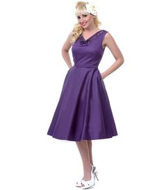 Purple swing dress with rhinestone accents