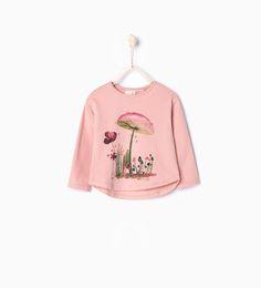 T-shirt avec un champignon imprimé