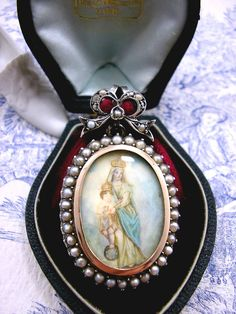 Antique Georgian Mourning Locket Miniature Painting Silver Gold Pearl by KittysJewelryBox on Etsy https://www.etsy.com/listing/87964009/antique-georgian-mourning-locket