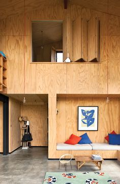 "A built-in bench helped architect Davor Popadich keep costs down for his New Zealand abode and adds a distinctive look to the interior. ""I detailed the house so its construction would involve as few tradespeople as possible,"" he says. ""For example, the internal doors, the built-in seats, and the bathroom and kitchen cupboards were all made onsite by the builder—and the built-in seats saved us money on furniture."" Photo by: Simon Devitt"