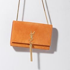 Love this cute little bag- This season, show off your Saint Laurent shoulder bag in the brightest colour. It's sure to pop next to boho separates in muted palettes. Covet Fashion, Fashion Bags, Fashion Handbags, Ysl Bag, Saint Laurent Bag, Orange Bag, Little Bag, Bag Accessories, Purses