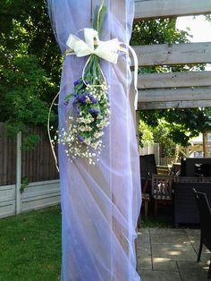 Pillar tied flowers