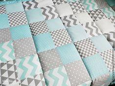 Купить или заказать Детское лоскутное одеяло, покрывало в интернет-магазине на Ярмарке Мастеров. Детское легкое одеяло (покрывало) на кроватку. Выполнено в технике пэчворк. Для пошива использовались качественные хлопковые ткани. Внутри тонкий слой синтепона. Простегано по всему периметру. В таком же стиле могут быть выполнены бортики на кроватку, корзиночки для мелочей, кармашки на кроватку,…