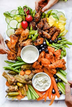 Healthier crispy baked chicken wings are dressed in four different sauces and teamed up with all the dips for a chicken wing platter thats sure to score. Fingers Food, Party Food Platters, Party Trays, Crispy Baked Chicken Wings, Cooking Recipes, Healthy Recipes, Sauce Recipes, Chicken Recipes, Healthy Salty Snacks