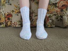 Here is a wonderful pair of hand knit adult size socks. Heel to toe is approx. 9 in. and the ribbing on the top (top to ankle) is approx. 5 1/2 in. These socks are made of 100% acrylic yarn and can be machine washed and dried.