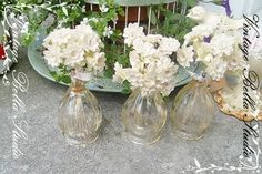 These lovely vintage perfume bottles hold simple garden flowers.