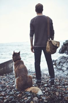 Man's best friend(s) – his dog and worn-in denim.