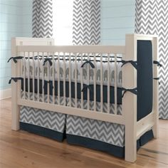 Grey chevron and navy blue nursery; could use teal as accent color and tie in guest bed