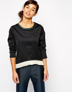 Sweatshirt by The Laden Showroom Smooth, satin touch fabric Round neckline Faceted, jewel stone trim Contrast pleating to the hem Regular fit - true to size Hand wash 100% Polyester Our model wears a UK S/EU S/US XS