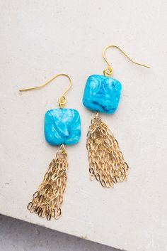 Harriet; Blue & gold fringe earrings, $28.99 Buy Fair Trade and help restore hope to exploited women in Asia