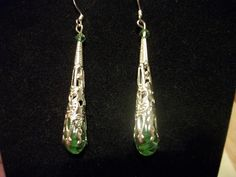 'Green With Envy Earrings' is going up for auction at  3pm Mon, Oct 8 with a starting bid of $5.