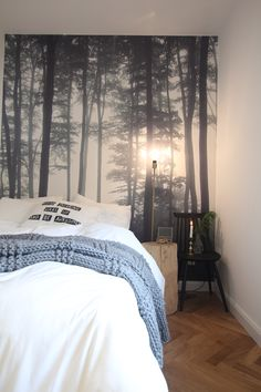 Cozy bedroom with forest wallpaper and retro chair. Design by Studio10/15 Nadia Mitłosz