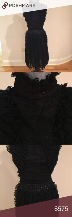 Alexander McQueen Dress Alexander McQueen Black Silk Lace Dress.  Beautiful detail.  Scallop hem.   Semi sheer top.  Bottom is lined.  Side zipper.  Button at back of neck. Purchased in NYC on 5th Ave.  comes with heavy duty Alexander McQueen Garment Bag.  Runway Dress. Alexander McQueen Dresses