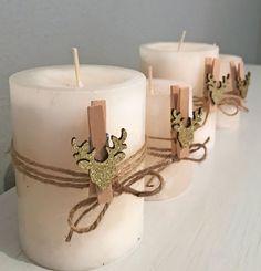 Kerzen hübsch geschmückt für Weihnachten