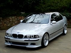 BMW E39 M5 Titanium Silver with sink drain mod, projector headlights with angel eyes and black-out grills, sport mirrors. tinted windows.