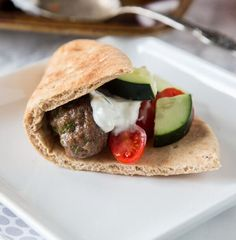 Sheet Pan Greek Meatballs - Greek flavored meatballs make for an easy dinner. Serve with tzatziki sauce for dipping and pitas to make gyros.