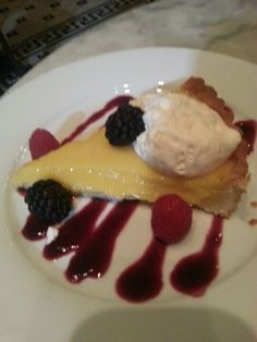 Tart citron with blueberry sauce and berries at coquette