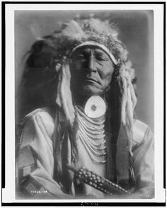 Bear Cut Ear  1 photographic print. | Head-and-shoulders portrait of Crow man.  Contributor:Curtis, Edward S. Original Format:Photos, Prints, Drawings Date:1908