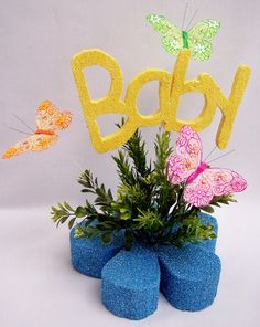 """Baby table centerpiece with silk greenery, butterflies and styrofoam word """"baby"""" cutout, great for a baby shower. Christening Centerpieces, Baby Shower Centerpieces, Baby Shower Decorations, Unique Baby Shower, Baby Shower Themes, Baby Shower Gifts, Shower Ideas, Butterfly Centerpieces, Centerpiece Decorations"""