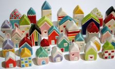 ceramic miniature houses from http://www.etsy.com/listing/92588102/sale-little-windows-house-orange-blue