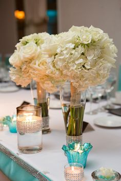 Tiffany blue wedding - bridesmaids bouquets and candles with crystal accents