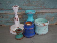 This is a hand painted and distressed a collection of 5 turned wooden candlesticks. A seaside color palette of blues and white. Painted Candlesticks, Seaside, Candle Holders, Unique Jewelry, Handmade Gifts, Collection, Vintage, Etsy, Kid Craft Gifts