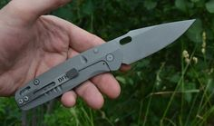 RF2 Framelock - Deeply Carved Titanium and Silver Twill