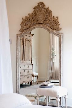 Love the ornate carvings! / French style bedroom