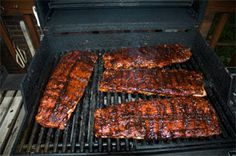 recipe for making the best barbecue ribs you ever tasted. Just like the champion pitmasters do it. They are coated with a dry rub, then smoked low and slow for hours, and the sauce is added near the end and sizzled on. Best Bbq Ribs, Barbecue Ribs, Barbecue Recipes, Grilling Recipes, Bbq Brisket, Barbecue Sauce, Carne Asada, Ribs On Gas Grill, Boiled Ribs Before Grilling