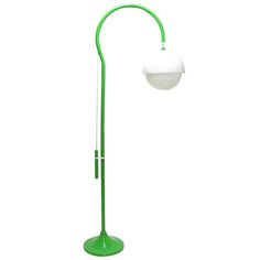 """An imposing adjustable 1970s """"model 4055"""" floor lamp by Luigi Bandini Buti for Kartell. In green enamelled steel with cream two-tier perspex shade the 4055 is the largest of this important architect's lamp designs.  Designed in 1967, this impressive lamp emits a soft, warm light, diffused by the thick perspex. The shade height can be easily adjusted with a smooth counterweight mechanism.   The condition of this lamp is very good and fully functional, with a few minor marks to the stem and…"""