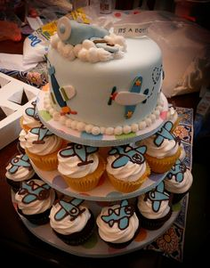 This is my first cake order! It& for a baby shower of a Navy pilot& wife who is expecting a baby boy. The cake is covered in fondant and the planes are fondant as well. The cupcake decorations are piped melted chocolate and vanilla wafers. Baby Shower Niño, Shower Bebe, Baby Shower Cakes, Baby Shower Themes, Diaper Shower, Baby Cakes, Shower Ideas, Airplane Birthday Cakes, Airplane Party