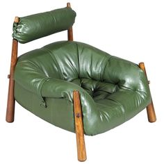 Leather Armchair and Footstool by Percival Lafer | From a unique collection of antique and modern lounge chairs at http://www.1stdibs.com/furniture/seating/lounge-chairs/