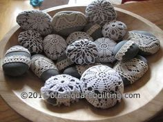 """Crochet doilies to fit rocks. Nice decoration idea. You could probably crochet small ones to fit and decrease around the back of the rock so it looks """"cleaner""""."""