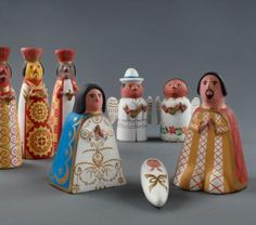This nativity scene from Yucatán, Mexico, was fashioned from clay using figurine molds—a ceramic technique that dates back to the Aztecs.  One of the angels plays a jarana, a traditional Mexican instrument adapted from Spanish guitars.  Both angels are dressed in clothing native to Yucatán..