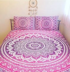 Best selling 'Ombre Flourish' large size mandala bed sheet.These soft cotton sheets are hand printed in Jaipur in a fabulous ombre technique with matching pillowcases.Crisp white base with berry purple mandala graduating to candy pink with floral paisley background pattern.Really versatile, they look great on a bed or sofa as a decorative throw and can be hung on the wall. They also make fabulous table cloths or beach blankets.Fits perfectly over a UK double/...