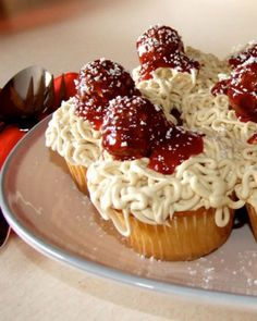 "Spaghetti Cupcakes - User Jessicakes serves up a spin on a classic Italian-American dinner: Vanilla cupcakes with vanilla ""spaghetti"" icing, fresh strawberry ""marinara"" sauce, and chocolate hazelnut ""meatballs."" It's all dusted with shredded white-chocolate ""Parmesan cheese."""