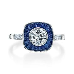 Armadani platinum and French carree cut blue sapphire vintage ring for an approximately 1ct center stone, 1.90 tcw sapphires and 0.15 tcw round brilliant diamonds.