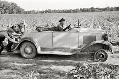 """June 1939. """"Pushing a car belonging to agricultural day laborer to start it, near Muskogee, Oklahoma."""""""
