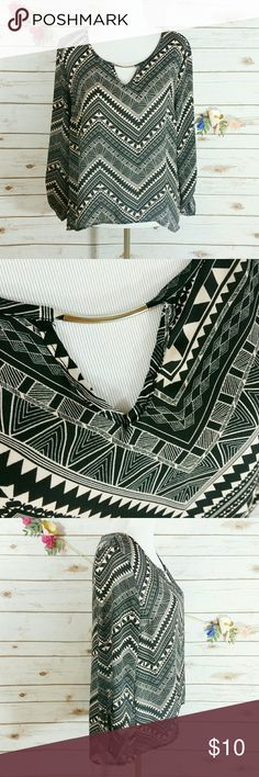 """Charlotte Russe zig zag semi sheer top This semi sheer top is black and beige with gold embellishments. The sleeves are 3/4 that are rolled and buttoned (see 4th picture). The back is slightly longer than the front. Length from arm pit to bottom of the front is approx 15"""". Length from arm pit to bottom of the back is approx 18"""". Bust is approx 38"""". 100% polyester. All measurements taken unstretched. In great condition! Charlotte Russe Tops Blouses"""