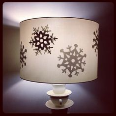 Snowflake lamp shade. Could add snowflakes to interior of shade just for the winter