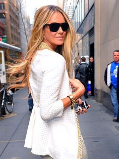 Elle Macpherson: Gorgeous white blazer with a touch of gold. Love it all...
