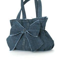 Recycled bow purse - eco friendly handbag - denim bow bag - upcycled jean purse. $60.00, via Etsy.