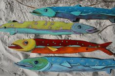These whimsical fish are made from 1/2 pine. Their lines are carved and bodies painted. The eyes come alive with a lampwork glass disc bead and